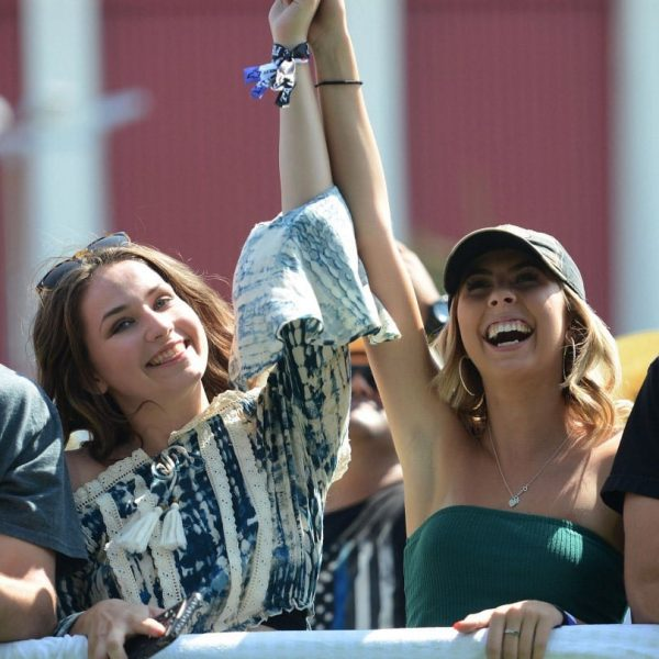 Country music fans Sydney Casteil and Kate Lee dance in the pit as Parmalee performs during Tailgate Fest Saturday, September 1, 2018 in The Forum parking lot in Inglewood. Fans were able to stay at their vehicles and tailgate throughout the show. (Photo by Will Lester, Inland Valley Daily Bulletin/SCNG)