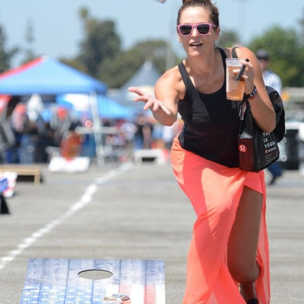 Country music Brandy Molitor, 35 from Cheyenne, Wyoming, plays corn hole with crushed beer cans prior to Tailgate Fest Saturday, September 1, 2018 in The Forum parking lot in Inglewood. Fans were able to stay at their vehicles and tailgate throughout the show. (Photo by Will Lester, Inland Valley Daily Bulletin/SCNG)