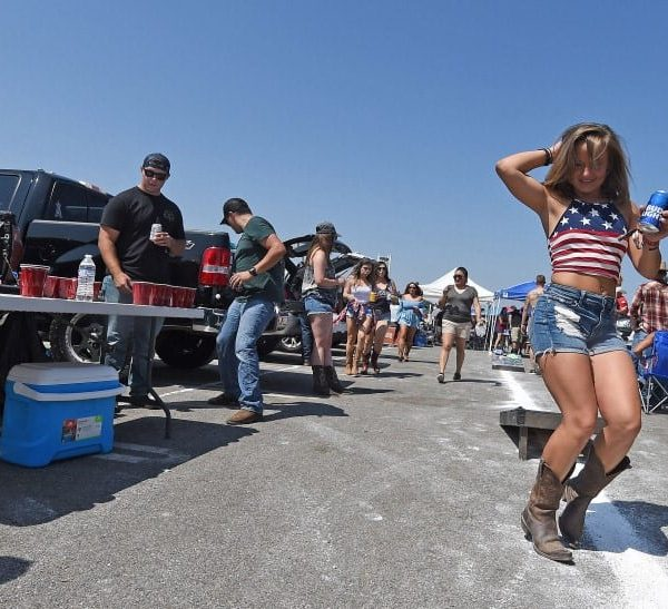 Country music fan Katie McClan, 27 from Oceanside dances in The Forum parking lot prior to Tailgate Fest Saturday, September 1, 2018 in Inglewood. Fans were able to stay at their vehicles and tailgate throughout the show. (Photo by Will Lester, Inland Valley Daily Bulletin/SCNG)