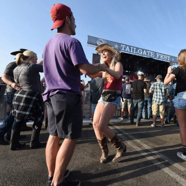 Country music fans Joel Barshaw, 26 from Columbia, Maryland, dances with Michaela Mueller, 24 from Irvine, as Joe Nichols performs at Tailgate Fest Saturday, September 1, 2018 in The Forum parking lot in Inglewood. Fans were able to stay at their vehicles and tailgate throughout the show. (Photo by Will Lester, Inland Valley Daily Bulletin/SCNG)